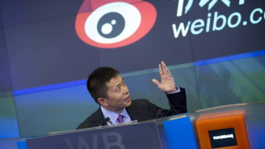 Charles Chao, chief executive officer of Sina, attends the IPO ceremony for Weibo at the Nasdaq in New York on April 17, 2014.